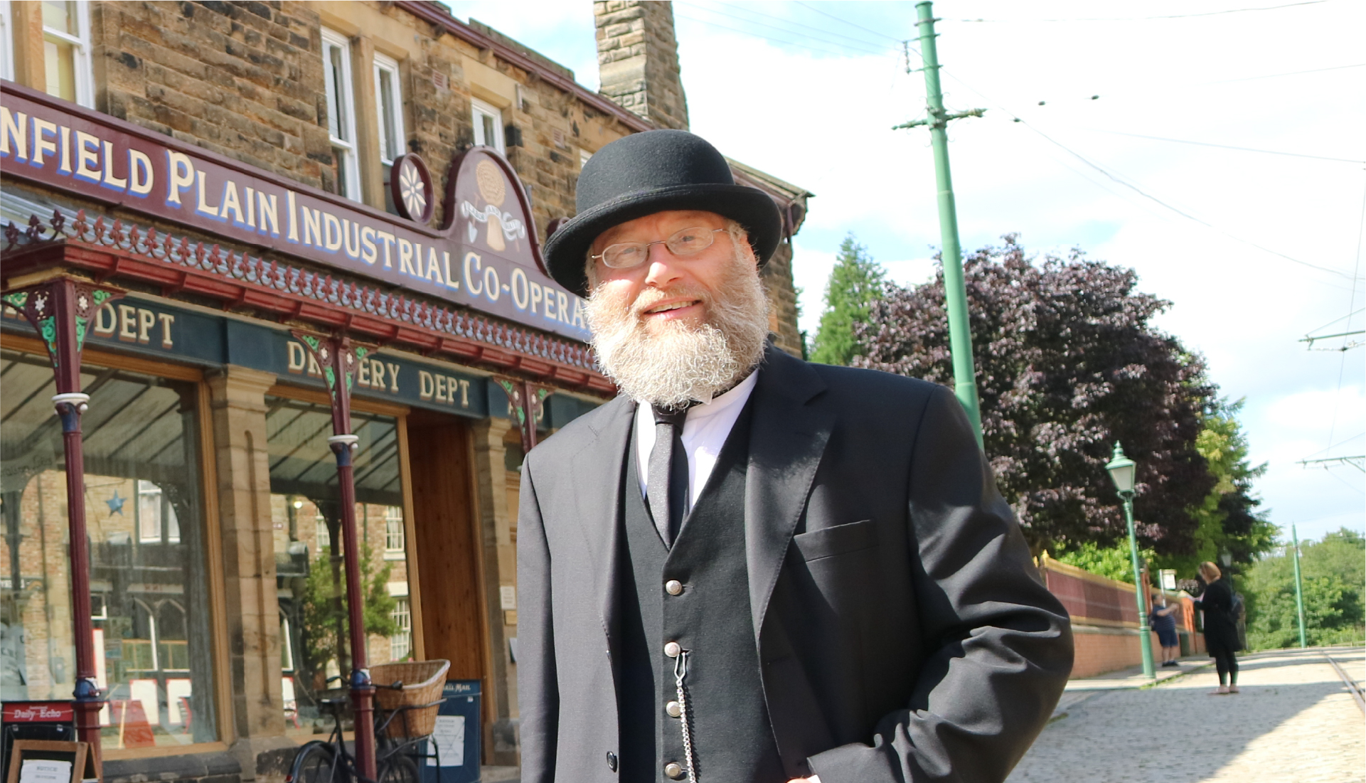 Man in bowler hat and suit at Beamish