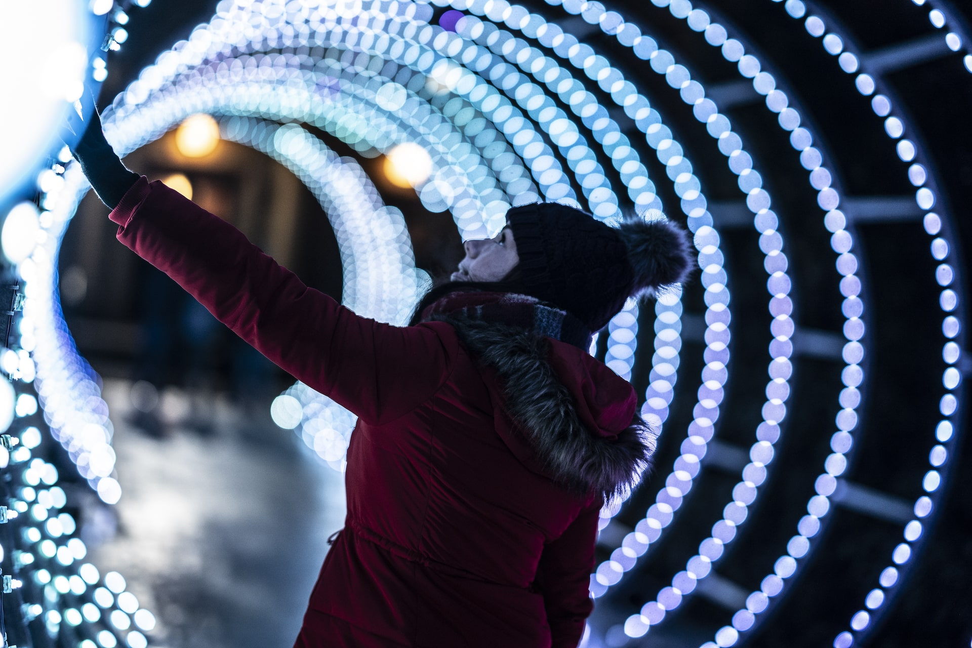 Woman in light tunnel at Durham Lumiere